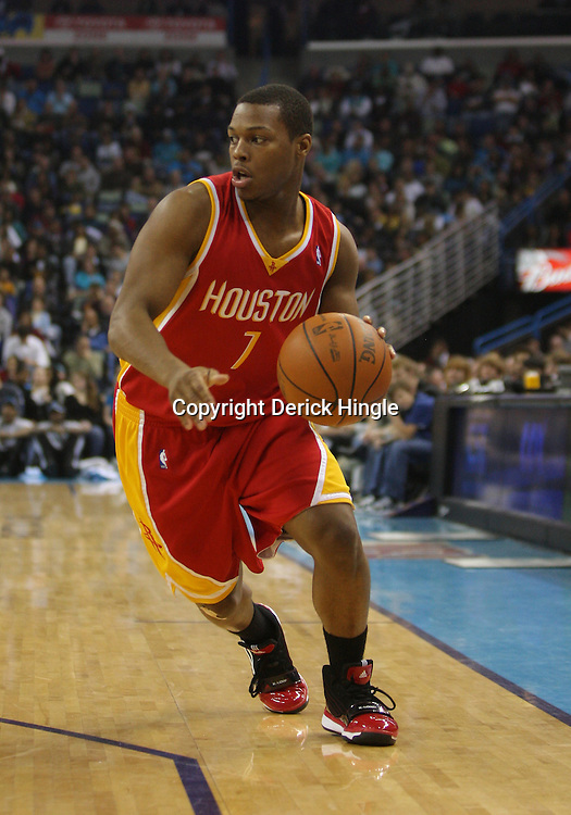 Jan 02, 2010; New Orleans, LA, USA; Houston Rockets guard Kyle Lowry (7) drives with the ball against the New Orleans Hornets during a game at the New Orleans Arena. The Hornets defeated the Rockets 99-95.  Mandatory Credit: Derick E. Hingle-US PRESSWIRE