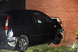 © Licensed to London News Pictures. 03/11/2013<br /> A Ford Zetec has Crashed into the side of a house on Goldfinch Road, Thamesmead,South East London, Opposite Belmarsh Prison.  The Vehicle has smashed into the property causing cracks to appear at the back corner of the house. Workmen are on scene erecting scaffolding to support the building.<br /> Traffic Delays expected on Western Way,Thamesmead in the Morning.<br /> Photo credit :Grant Falvey/LNP