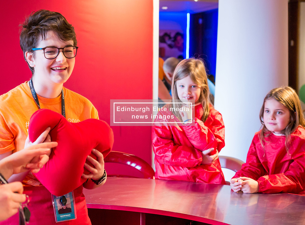 City Arts Centre, Edinburgh, Scotland, United Kingdom, 9 April 2019. Edinburgh Science Festival:  India and Lucy, age 8 years, have fun learning about blood at the Blood Bar drop in event with Science Communicator Hannah at the Science Festival. <br /> <br /> Sally Anderson | EdinburghElitemedia.co.uk