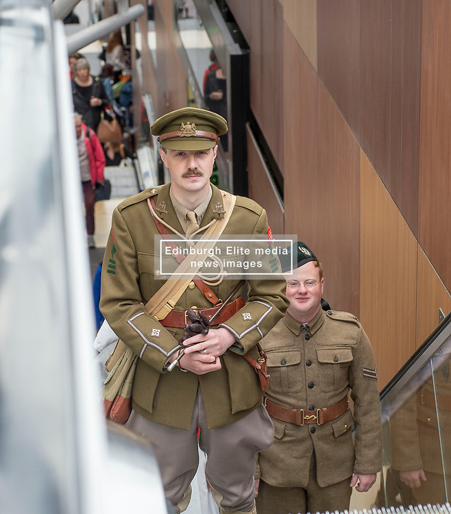 100 years to the day from when the celebrated Great War poet Wilfred Owen arrived for treatment in Edinburgh the ocassion was marked with a re-enactment of that arrival and the historic walk he made along Princes Street. Pictured is Wilfred Owen, played by David Clarke of the Scots in the Great War Living History Society, along with fellow actors in WW1 costume Ailsa Clarke and Adam Williams.<br /> <br /> © Dave Johnston/ EEm