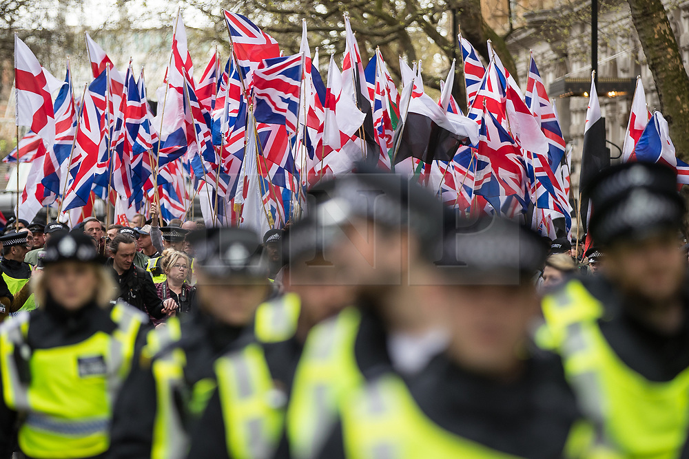 © Licensed to London News Pictures . 01/04/2017 . London , UK . Britain First marches along Northumberland Avenue . The EDL and Britain First both hold demonstrations in London , opposed by anti-fascist groups , including Unite Against Fascism . Photo credit : Joel Goodman/LNP