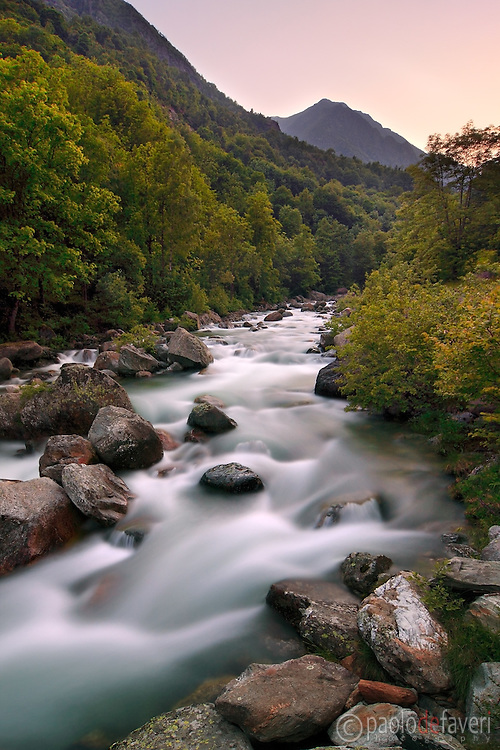 An autumnal view of the Chiusella river and its gorges. This is a very long exposure at sunset.