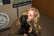 Tina Dokken snuggles with a Lab pup at Dokken's Oak Ridge Kennels in Minnesota
