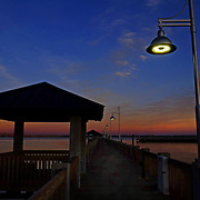 Bay Saint Louis Mississippi was hit hard by Hurricane Katrina in 2005 but has recovered well, rebuilding it's shoreline, piers and adding new structures.  Even some of the live oak trees that were battered by the hurricane have been turned into spectacular sculptures by talented artists.  Sunsets are beautiful to view in the Gulf Coast town.