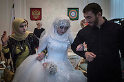 Tears on her wedding day: Heartbreaking pictures capture moment forlorn teenage bride was forced to marry a polygamous Chechen police chief after 'he threatened her with kidnap' <br /> <br /> Her resplendent white dress says it's her wedding day, but the sadness etched on her face does not.<br /> For this teenage bride has been forced to marry an ally of Chechen warlord Ramzan Kadyrov after apparently being threatened with kidnap if she did not comply.<br /> Kheda Goilabiyeva, 17, looked despondent and at one point wept during the ceremony in the Chechen capital Grozny as the fearsome Kadyrov watched on from the crowd.<br /> She was asked three times whether she wanted to marry 47-year-old police chief Nazhud Guchigov – who already has another wife – before finally and reluctantly responding yes. <br /> <br /> <br /> The marriage has provoked outrage in Russia, fuelled by Moscow's child rights commissioner, Pavel Astakhov, who defended the wedding by saying that Caucasian women 'are all shrivelled with wrinkles by the age of 27'. He later apologised for his comments.<br /> In response to the remarks, young women online have started posting selfies on Instagram with the hashtag #WrinkledWoman in which they scrunch up their faces to simulate the appearance of wrinkles. Many of the posts include sarcastic greetings to Astakhov.<br /> <br /> <br /> The woman behind the campaign appears to be Bella Rapoport, a prominent Russian feminist writer, according to Instagram's time stamps.<br /> The second contributor appears to be Tonia Samsonova, a popular journalist at Echo of Moscow with a large online social media following. <br /> Within 12 hours, the hashtag has attracted more than 120 contributions. <br /> <br /> Kadyrov, who has ruled Chechnya with an iron fist since being installed by Russian President Vladimir Putin in 2007, was said to have given his personal blessing for the marriage in apparent violation of Russian laws against polygamy.<br /> The procession then carried on to a restaurant, where Kadyrov was present and celebrated with traditional dan