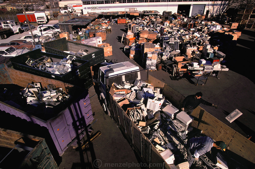 "Silicon Valley, California; Essential Elements computer recycling yard in San Jose. Owner and founder Bob Kaiser was a roofing contractor who panned for gold in California rivers on weekends until a friend told him ""there's gold in computers"". He started by scavenging dumpsters and now runs a multi-million dollar business recycling computers for precious metals and for scrap sales to mainland China. (1999)."