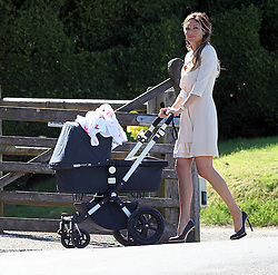 Robbie Williams father Pete Conway wedding. Robbie Williams wife Anya Field pushing the buggie with their baby at Compton Bassett home of Robbie Williams, UK,  May 1, 2013. Photo by: Roger Allen / i-Images. UK ONLY<br />