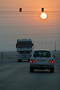 Toyota Landcruiser, Mercedes Actros at sunset.