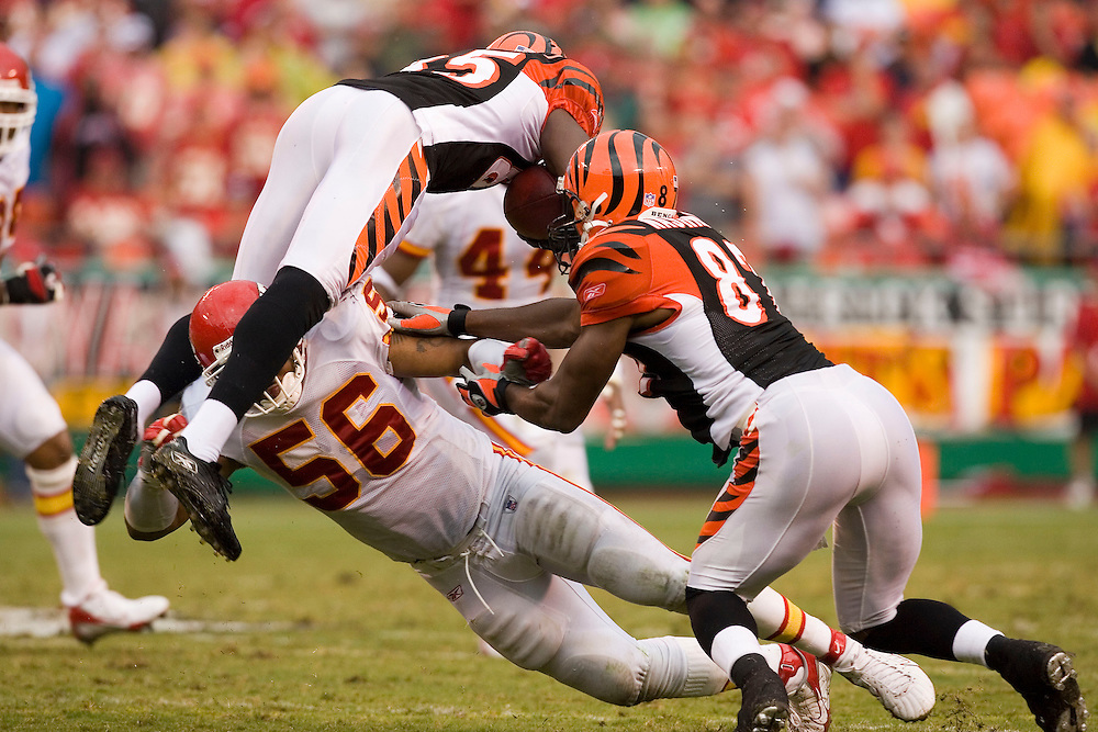 KANSAS CITY, MO - SEPTEMBER 10:  Wide receiver Chad Johnson of the Cincinnati Bengals jumps over linebacker Derrick Johnson of the Kansas City Chiefs on September 10, 2006 at Arrowhead Stadium in Kansas City, Missouri..The Bengals won 23 to 10.  (Photo by Wesley Hitt/Getty Images)***Local Caption*** Chad Johnson