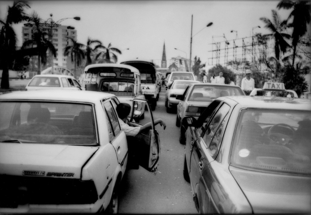 Cars line up for petrol/gasoline in the days following Cyclone Nargis as prices immediately rose to 10,000 Kyats/gallon (US$ 10/ gallon) in a country where the average person lives on US$0.60/day, Yangon, Burma (Myanmar).  1 gallon = 3.8 liters.