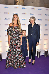 The Prime Minister Theresa May, Miss Aliena Wigan and Lady Jubie Wigan at The Sugarplum Dinner 2017 to benefit the type 1 diabetes charity JDRF held at the Victoria & Albert Museum, Cromwell Road, London England. 14 November 2017.<br /> Photo by Dominic O'Neill/SilverHub 0203 174 1069 sales@silverhubmedia.com