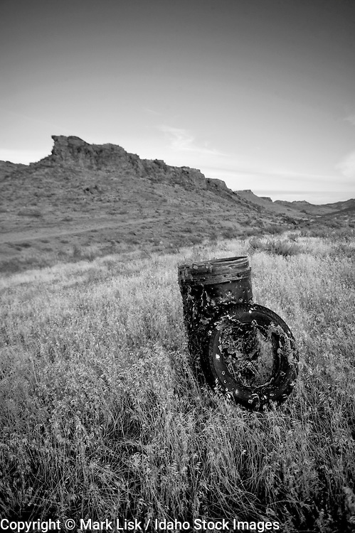 Bullets riped trough a barrel and tire in the farm and ranch country of southern Idaho.