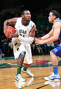 Dec 07, 2011; Birmingham, AL, USA;  Middle Tennessee Blue Raider guard Raymond Cintron (15) guards UAB guard Preston Purifoy  (24) at  Bartow Arena. The Blazers defeated the Blue Raiders 66-56 Mandatory Credit: Marvin Gentry-