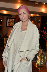 LONDON, ENGLAND 2 DECEMBER 2016: <br /> Amber le Bon at a breakfast attended by a host of influencers, press and VIPs to celebrate the official launch of EVARAE the new British luxury resort wear brand, held at The Hari Hotel, 20 Chesham Place, London.  England. 2 December 2016.
