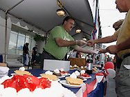 John Florentine of Kettering (left) serves up some of Bob Evans pie samples during Taste of Miami Valley and Home Show in downtown Dayton, Saturday, September 18, 2010.