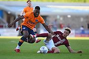 Northampton Town midfielder Shaun McWilliams (17) slides in to tackle Oldham Athletic striker (on loan from Wolverhampton Wanderers) Duckens Nazon (12) during the EFL Sky Bet League 1 match between Northampton Town and Oldham Athletic at Sixfields Stadium, Northampton, England on 5 May 2018. Picture by Dennis Goodwin.