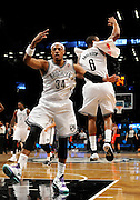 Brooklyn Nets' Paul Pierce (34) and Alan Anderson (6) celebrate Pierce's three pointer against the Toronto Raptors that put the Nets in the lead 97-94 during an NBA basketball game on Monday, March 10, 2014 at Barclays Center in New York. (AP Photo/Kathy Kmonicek)