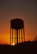A water tower is an elevated structure supporting a water tank constructed at a height sufficient to pressurize a water supply system for the distribution of potable water, and to provide emergency storage for fire protection. Some water towers may only store raw (non-potable) water for fire protection or industrial purposes, and may not necessarily be connected to a public water supply.