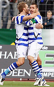 Duisburg's Soren Larsen and Christian Tiffert celebrate. 1st November 2009.