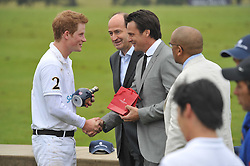 Left to right, HRH PRINCE HARRY,  Christian Porta CEO of Chivas Brothers and ERIC DEARDORFF at the Sentebale Polo Cup held at Coworth Park, Berkshire on 12th June 2011.