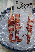 Japanese food. Octopus skewer on ice. Photographed in Osaka Food Market, Osaka, Japan