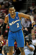 April 13, 2011; Cleveland, OH, USA; Washington Wizards point guard John Wall (2) signals to his bench during the first quarter against the Cleveland Cavaliers at Quicken Loans Arena. Mandatory Credit: Jason Miller-US PRESSWIRE