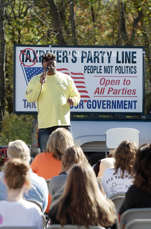 Middletown, New York - A man speaks before an Orange/Sullivan County 912 Tea Party forum with Republican gubernatorial candidate Carl Paladino in the parking lot outside party headquarters on Oct. 9, 2010.