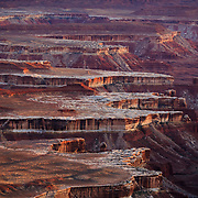 The canyon edges of the Whiterim Trail at sunset in Canyonlands National Park near Moab, Utah.