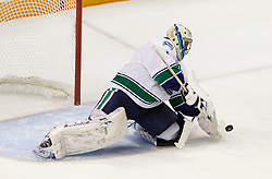 May 20, 2011; San Jose, CA, USA; Vancouver Canucks goalie Roberto Luongo (1) makes a save against the San Jose Sharks during the first period of game three of the western conference finals of the 2011 Stanley Cup playoffs at HP Pavilion. Mandatory Credit: Jason O. Watson / US PRESSWIRE