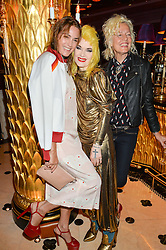 Left to right, YASMIN LE BON. PAM HOGG and ELLEN VON UNWERTH at a party to celebrate Pam Hogg receiving an honorary Doctorate from Glasgow University held at Park Chinois, 17 Berkeley Street, London on 11th July 2016.