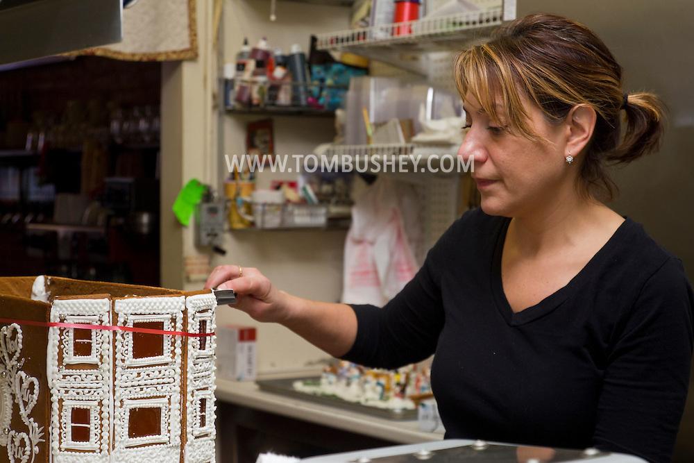Middletown, New York - Gingerbread House construction at Something Sweet Dessert Cafe on  Nov. 23, 2014.