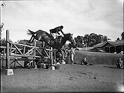 Billy Ringrose/Captain John Brooke at the R.D.S Horse Show, Tuesday.<br /> 08.08.1961