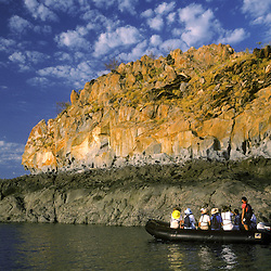 Adventure travelers viewing signs of the massive tidal changes of the Prince Regent River in Zodiac rafts. Kimberley, W. AUSTRALIA