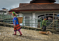 BAC HA, VIETNAM - CIRCA SEPTEMBER 2014:  Hmong woman walking at  Bac Ha sunday market, the biggest minority people market in Northern Vietnam