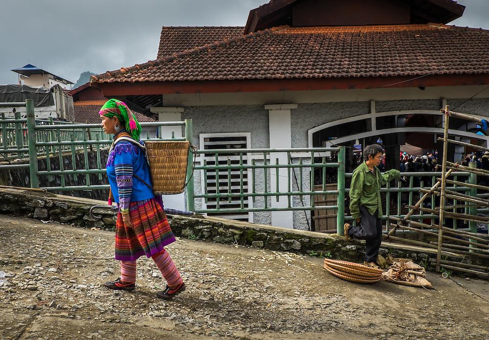 BAC HA, VIETNAM - CIRCA SEPTEMBER 2014:  Hmong woman walking at  Bac Ha sunday market, the biggest minority people market in Northern Vietnam