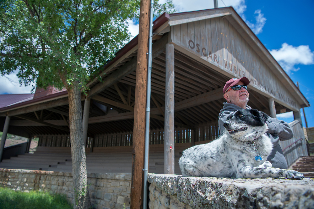em051917p/jnorth/Dale McDonnell, with his dog Lola, and other volunteers have been working to restore the Oscar Huber Memorial Ballpark in Madrid. Photo shot Friday May 19, 2017. (Eddie Moore/Albuquerque Journal