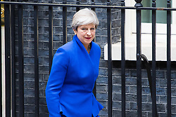 London, June 9th 2017. British Prime Minister Theresa May leaves Downing Street on her way to Buckingham Palace to seek Her Majesty The Queen's permission to form a government following the general election where her Conservative Party lost is majority in the House of Commons.
