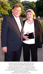 Top selling writer BARBARA TAYLOR BRADFORD and her husband MR ROBERT BRADFORD at a party in London on 24th June 2003.PKW 90