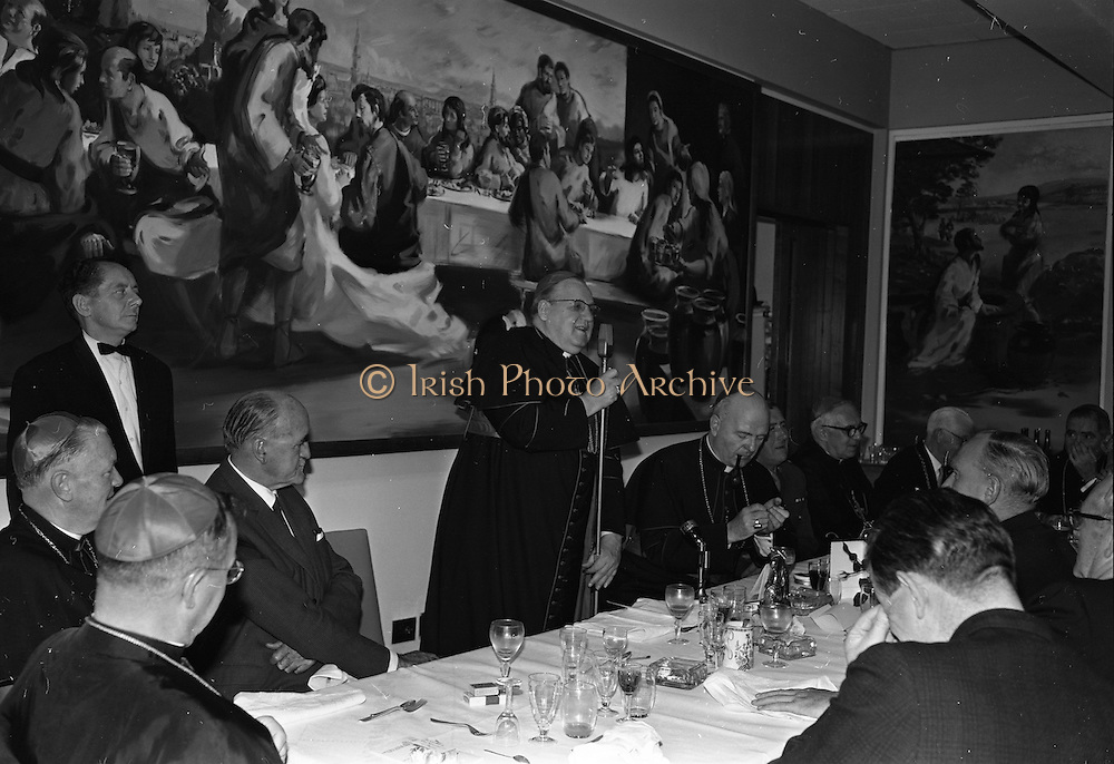 10/07/1967<br /> 07/19/1967<br /> 19 July 1967<br /> Cardinal John Cody of Chicago with American pilgrims in Drogheda. Cardinal Cody led 350 pilgrims to the shrine of Blessed Oliver Plunkett in Drogheda. There in the Cathedral he and His Eminence Cardinal William Conway Archbishop of Armagh and Primate of All Ireland consecrated Mass. After mass the Cardinals and pilgrims went to the Medical Missionaries of Mary Hospital for lunch. Image shows Cardinal Cody speaking at the lunch, which was attended by Minister for External Affairs Mr. Frank Aiken TD.