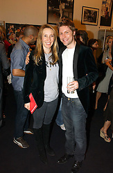 SAM TAYLOR-WOOD and CHRISTOPHER BAILEY creative director of Burberry at a party to celebrate the opening of Photo-London 2006 at Burlington Gardens, London W1 on 17th May 2006.<br />