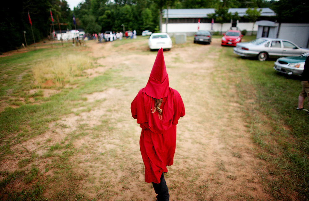 Kyle Green | The Roanoke Times<br /> 7/2/2011 A member of the Rebel Brigade KKK group in Martinsville, Virginia walks in a red robe before one of six cross burnings held on rural land in southwest Virginia. The KKK is making a comeback in the USA helped by high unemployment and a growing distrust in the government.