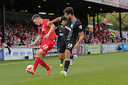 Mansfield Town defender Ryan Tafazolli gets a hold of York City forward Reece Thompson during the Sky Bet League 2 match between York City and Mansfield Town at Bootham Crescent, York, England on 29 August 2015. Photo by Simon Davies.