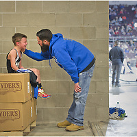 A tearful Angelo Lomonte, 8, is consoled by his father Angelo Lomonte, 39, both of Reynolds, after the eight-year-old was defeated 2-0 in a 45-pound eight-and-under match during the Pennsylvania Junior Wrestling Youth Championships at Erie Insurance Arena on Friday, March 20, 2015, in Erie, Pa.