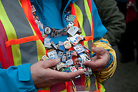 A volunteer shows off her collection of Olympic Pins at the 4-man bobsleigh finals during the 2010 Olympic Winter Games in Whistler, BC Canada.