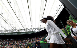 Venus Williams and Kim Clijsters walking out on No.1 court at The All England Lawn Tennis Club, London.
