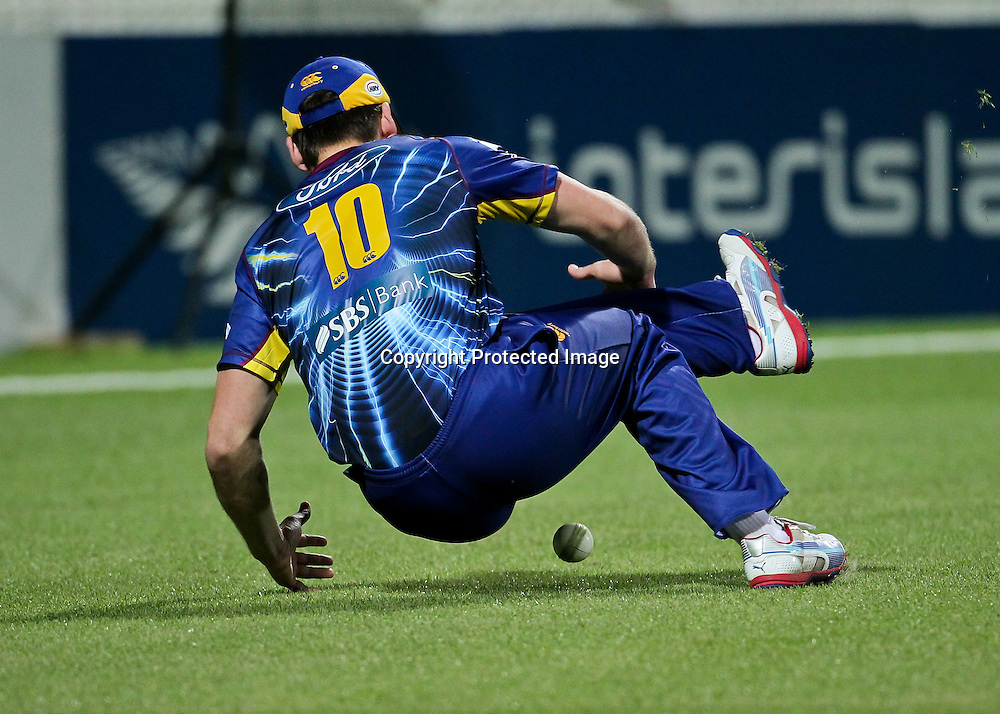 Otago Volt's Michael Bracewell drops Northern Knight's import player James Foster in the outfield during the HRV Cup - Northern Knights v Otago Volts, 2 November 2012.  Photo:  Bruce Lim / photosport.co.nz