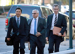 21st January, 2014. New Orleans, Louisiana.<br /> Anthony Badalamenti (mid) arrives at federal Court for sentencing with lawyers Tai Park (L) and Claude Kelly (R). Badalamenti, 62 yrs of Katy, Texas is the former Haliburton manager who plead guilty to destroying evidence in the aftermath of the 2010 BP Macondo Well oil rig disaster in the Gulf of Mexico. He faces a maximimum sentence of up to 1 year in prison and up tp $100,000 fine. Badalamenti was the cementing technology director for Haliburton Energy Services.