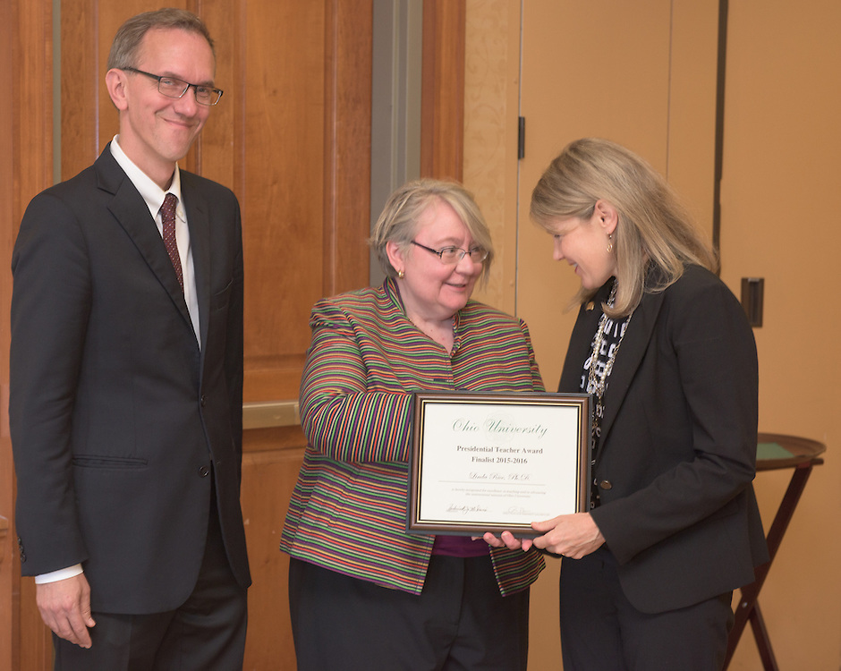 From left: Joseph Shields, Vice President for Research & Creative Activity and Dean of Ohio University's Graduate College along with Pam Benoit, Executive Vice President and Provost, congratulate Linda Rice for being a finalist for the Presidential Teacher Award during the 2016 Faculty Awards Recognition Ceremony held at Baker Center on Tuesday, September 6, 2016.