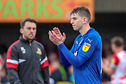 AFC Wimbledon defender Steve Seddon (15) clapping during the EFL Sky Bet League 1 match between AFC Wimbledon and Doncaster Rovers at the Cherry Red Records Stadium, Kingston, England on 9 March 2019.