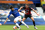 Bournemouth midfielder Dan Gosling (4) holds on to Everton midfielder Andre Gomes (21) during the Premier League match between Everton and Bournemouth at Goodison Park, Liverpool, England on 26 July 2020.